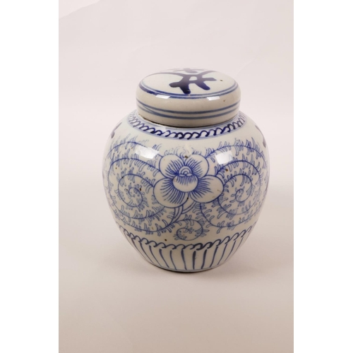 15 - A Chinese blue and white porcelain ginger jar and cover decorated with scrolling floral pattern and ...