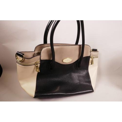 21 - Three designer style handbags...