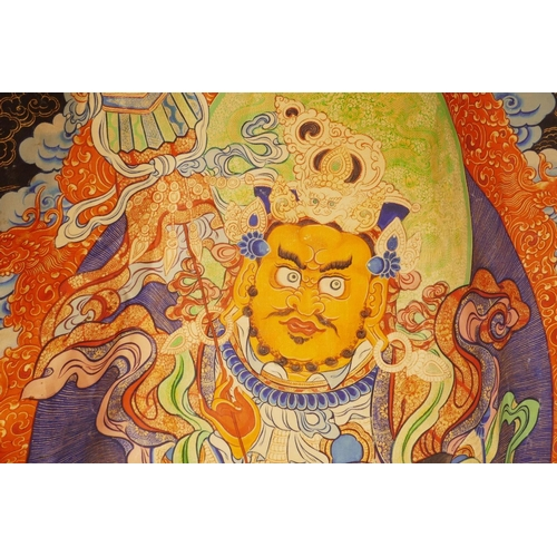 25 - A Sino-Tibetan printed thangka depicting a wrathful deity encircled by depictions of Buddha, 43