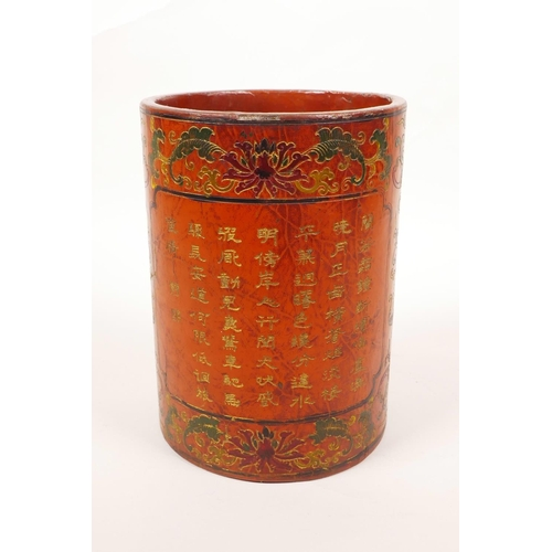 28 - A Chinese red lacquer brush pot decorated with bats, lotus flowers and gilt character inscriptions, ...