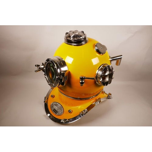 29 - A replica chrome and yellow enamelled USA diver's helmet, 17