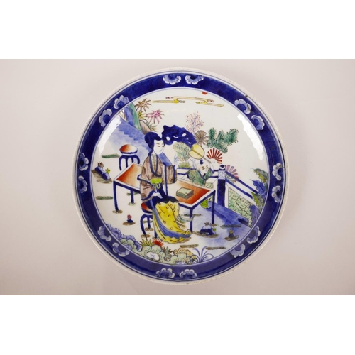 3 - A Chinese blue and white porcelain dish with polychrome enamel decoration of a woman and child, 9
