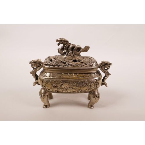30 - A Chinese silvered metal two handled censer with a pierced lid and dragon decoration, 6 character ma...