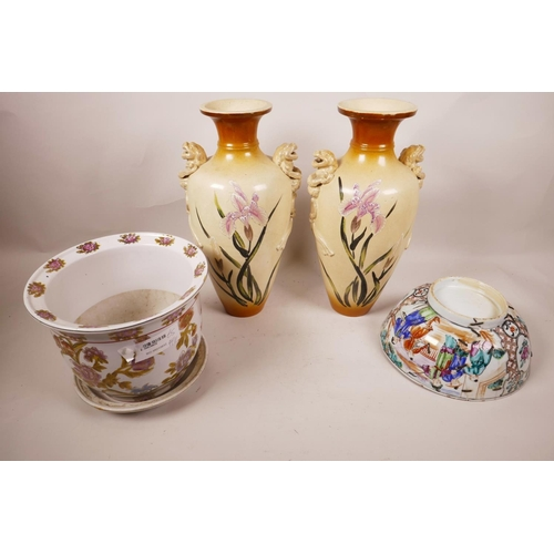 32 - A pair of Japanese porcelain vases with lion's mask handles, 12