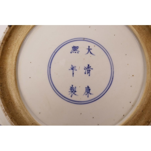 33 - A Chinese famille verte porcelain charger decorated with warriors on horseback, 6 character mark to ...