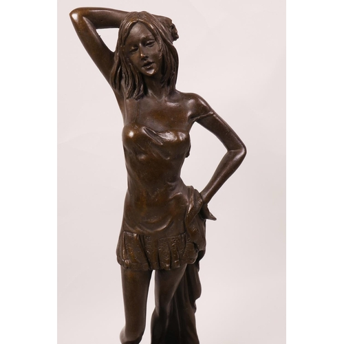37 - A bronze figurine of a semi-clad girl on a marble base, 12