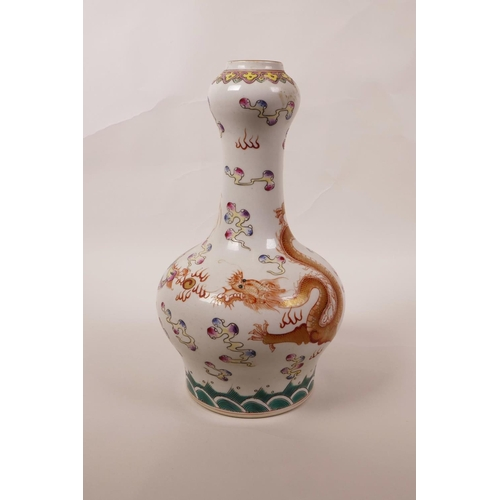 38 - A Chinese polychrome porcelain garlic head shaped vase with enamelled decoration of a dragon chasing...