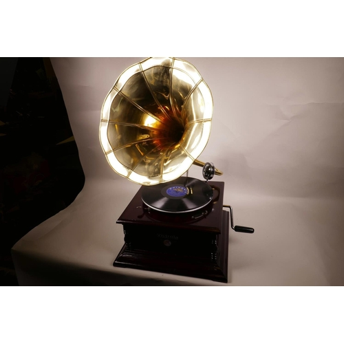 42 - A replica Victorola wind up horn gramophone with mahogany case and brass horn, 14½