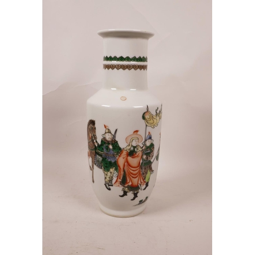46 - A Chinese famille verte porcelain Rouleau vase decorated with four warriors, 6 character mark to bas...