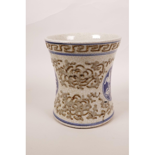 48 - A Chinese blue and white crackleware brush pot of waisted form with raised cursive patterns and deco...