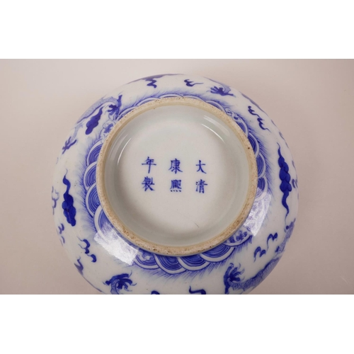 5 - A Chinese blue and white porcelain bowl decorated with a dragon chasing the flaming pearl, 6 charact...