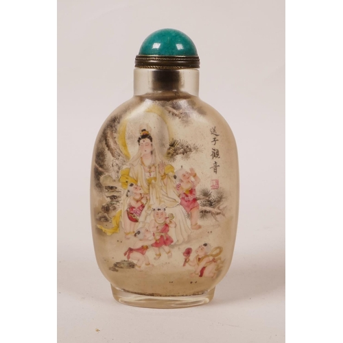 50 - A Chinese reverse painted glass snuff bottle decorated with Quan Yin and children, character inscrip...