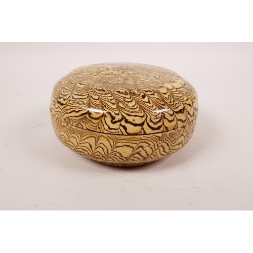 56 - A Chinese marbled pottery trinket box and cover, 4½