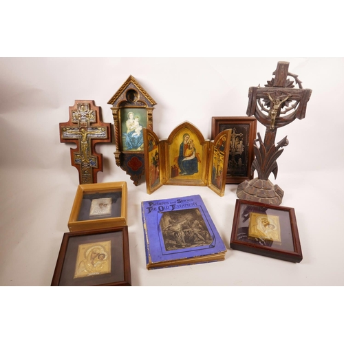 57 - A collection of ten religious artefacts, including six Madonna and Child icons, three of Christ on t...