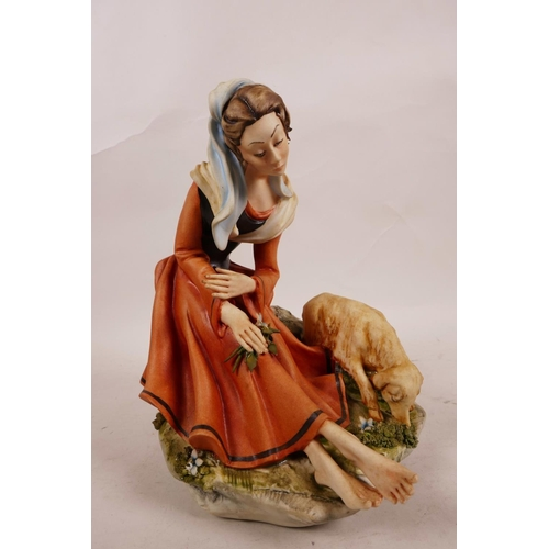 59 - A Capodimonte Cortese figurine of a seated lady with a lamb, signed 326 on the back, with blue 'N' a...