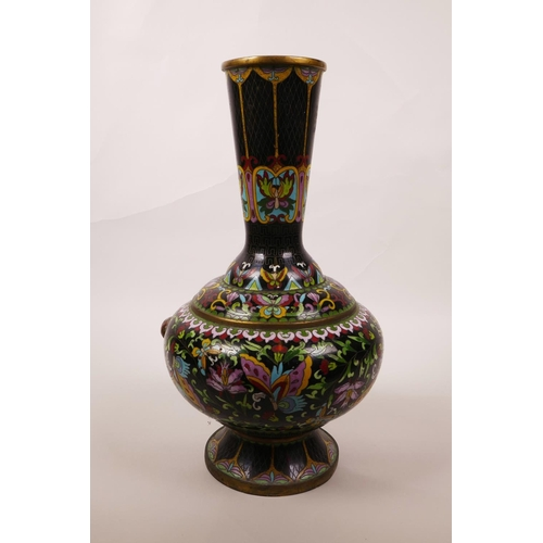 6 - A Chinese black ground cloisonné vase, decorated with butterflies and lotus flowers, A/F repair, 12