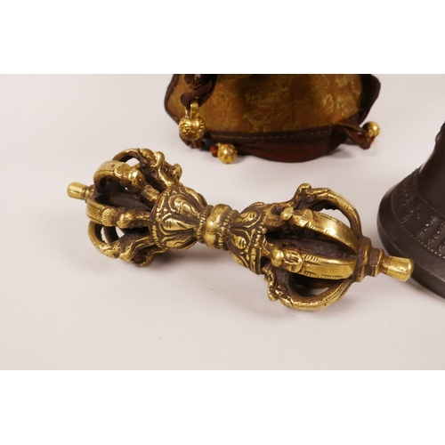 60 - A Sino-Tibetan bell with a brass handle in the form of a vajra, together with a brass ceremonial vaj...