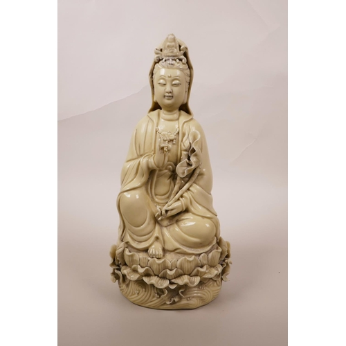 8 - A Chinese blanc de chine Quan Yin seated on a lotus throne, impressed seal mark verso, 10½