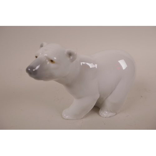 10 - Two Lladro polar bear figurines; 'Resting Polar Bear' and 'Attentive Polar Bear', stamped to base...