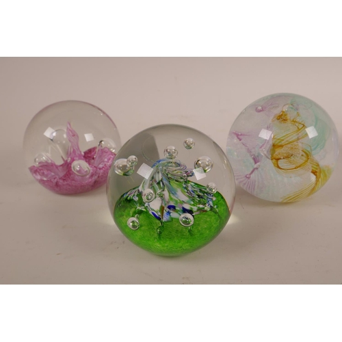 12 - Six Caithness paperweights, all numbered and individually titled; 'Moonflower', 'Goldrush', 'Fountai...