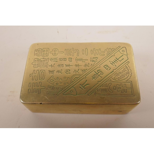 21 - A Chinese brass box, engraved with Chinese calligraphy and internally lined with copper (and possibl...