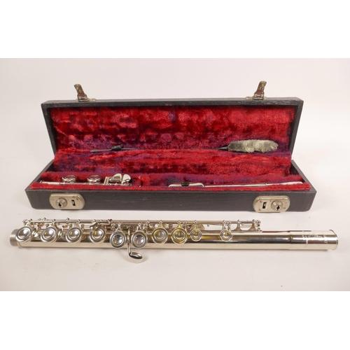 27 - A Boosey & Hawkes 'Regent' flute, serial number 343931, in original case...