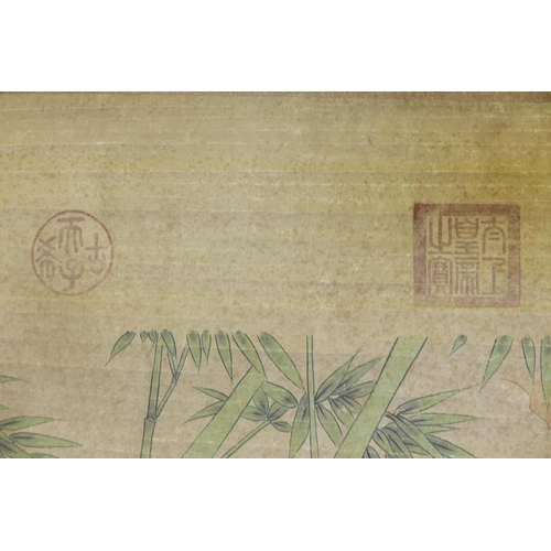 28 - A Chinese watercolour scroll decorated with two pheasants in a landscape, 26