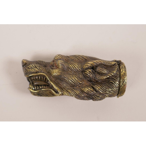 29 - A brass vesta case shaped as the head of a snarling dog, 13