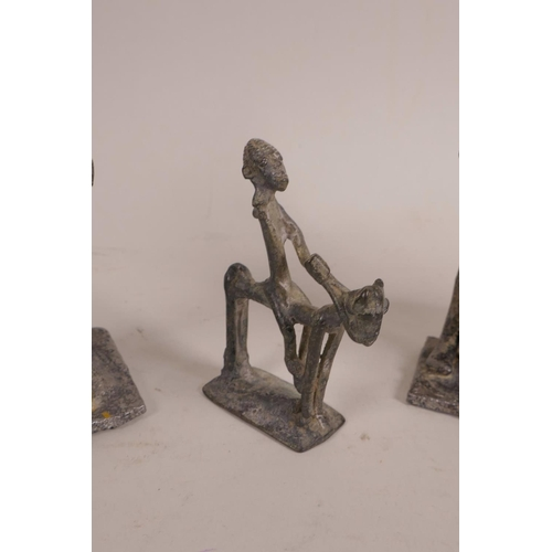 30 - An African Benin brass figure of a hunter, together with another small Benin bronze of a figure on h...