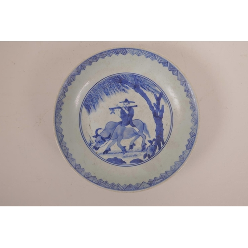33 - A Chinese blue and white porcelain dish decorated with a figure riding an ox, 8½