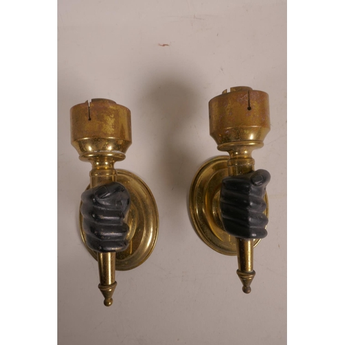 39 - A pair of brass wall lights, with bronze hands clasping the torcheres, 6