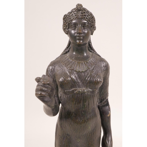 42 - A cast bronze figurine of a classical maiden, 10½