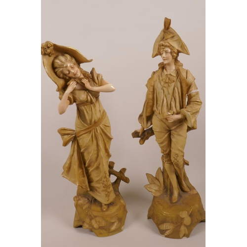 43 - A pair of Austrian Amphora figurines of a courting couple, marked EW. Turn Wien Austria, 13