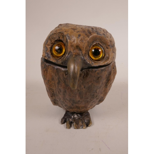 51 - A cold painted bronze owl inkwell, with glass eyes and  hinged head, in the style of Bergman, signed...