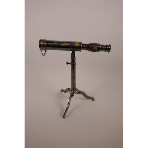 56 - A brass reproduction desktop telescope on stand, 9½