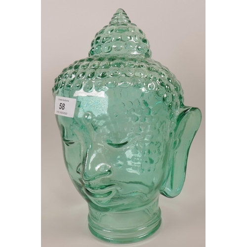 58 - A green glass Buddha head, 12