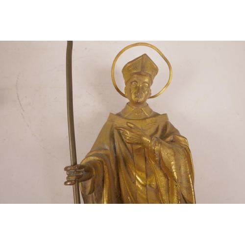 59 - A gilt bronze figure of a cardinal, mounted on a bracket,  18