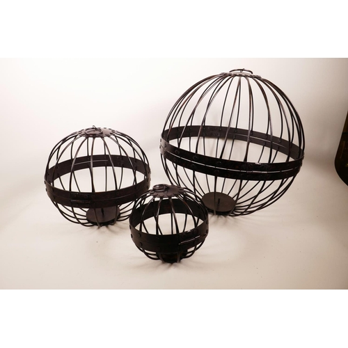 61 - A set of three graduated open wirework hanging planters, largest 4½