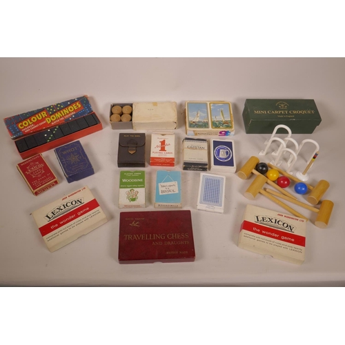 6 - A box of vintage games and playing cards including carpet croquet, dominoes etc...