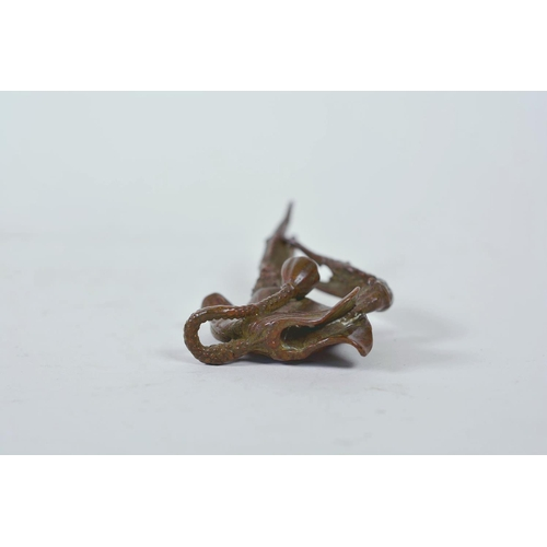 11 - An unusual Chinese bronzed metal model of a mythical creature, together with a parrot letter opener,...