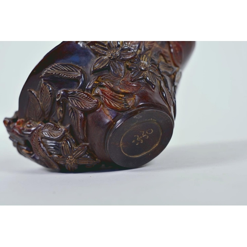 15 - A Chinese faux horn libation cup with carved floral decoration, chased mark to base, 4½