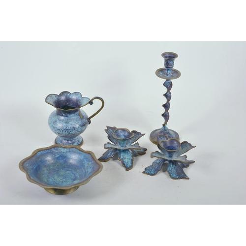 17 - A pair of verdigris brass dwarf candlesticks on petal shaped bases, 3