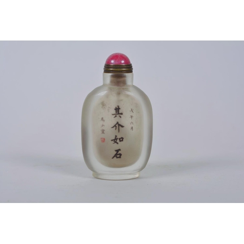 18 - A Chinese reverse decorated snuff bottle depicting a Chinese military gentleman, inscription verso, ...