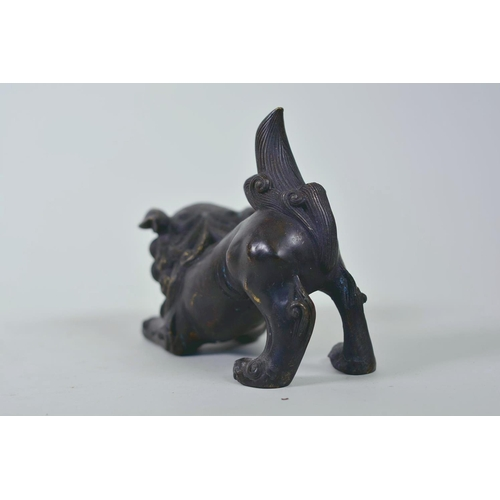 19 - A pair of Oriental patinated bronze figures of fo dogs, 6