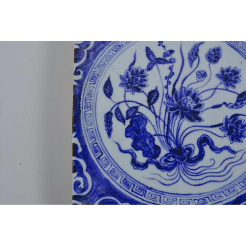 20 - A Chinese blue and white porcelain tile decorated with flowers, 8