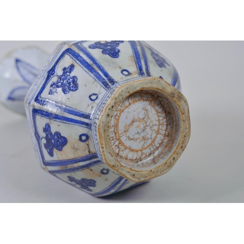 23 - A Chinese Ming style blue and white pottery pear shaped vase decorated with flowers, 12