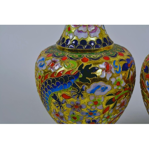 24 - A pair of Oriental cloisonné vases decorated with dragons, 8