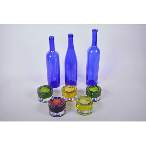 31 - Three 1970s blue glass bottles, largest 13