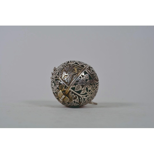 32 - A Chinese silvered metal incense holder pendant with a gimbal mounted reservoir and pierced lotus fl...