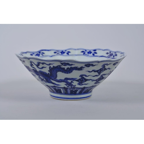 38 - A Chinese blue and white porcelain bowl with a lobed rim and dragon decoration, 6 character mark to ...